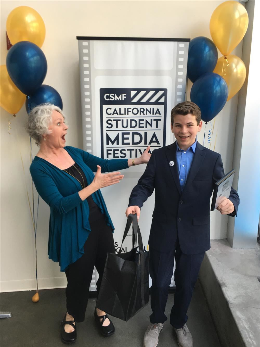 Student Kane Parsons and his teacher Laura Bradley at the California Student Media Festival