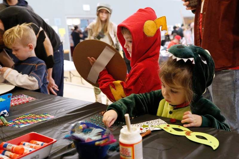 Young students decorate masks and shields in the kids' crafts area during LumaCON. Photo by Alvin Jo