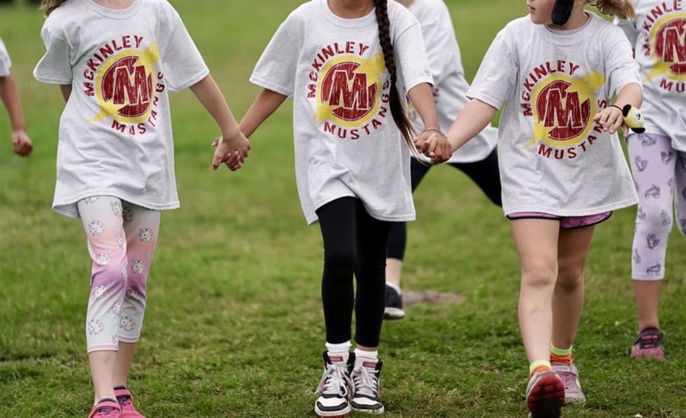 McKinley Students holding hands wearing McKinley t-shirts