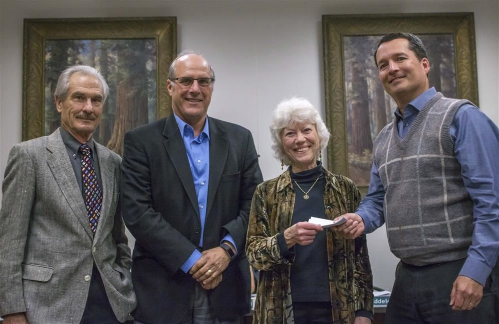 Rotary Club giving Board Members Donation