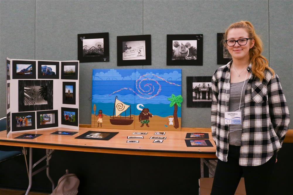 Casa Grande student at the 2018 Innovations Showcase with her photography and artwork