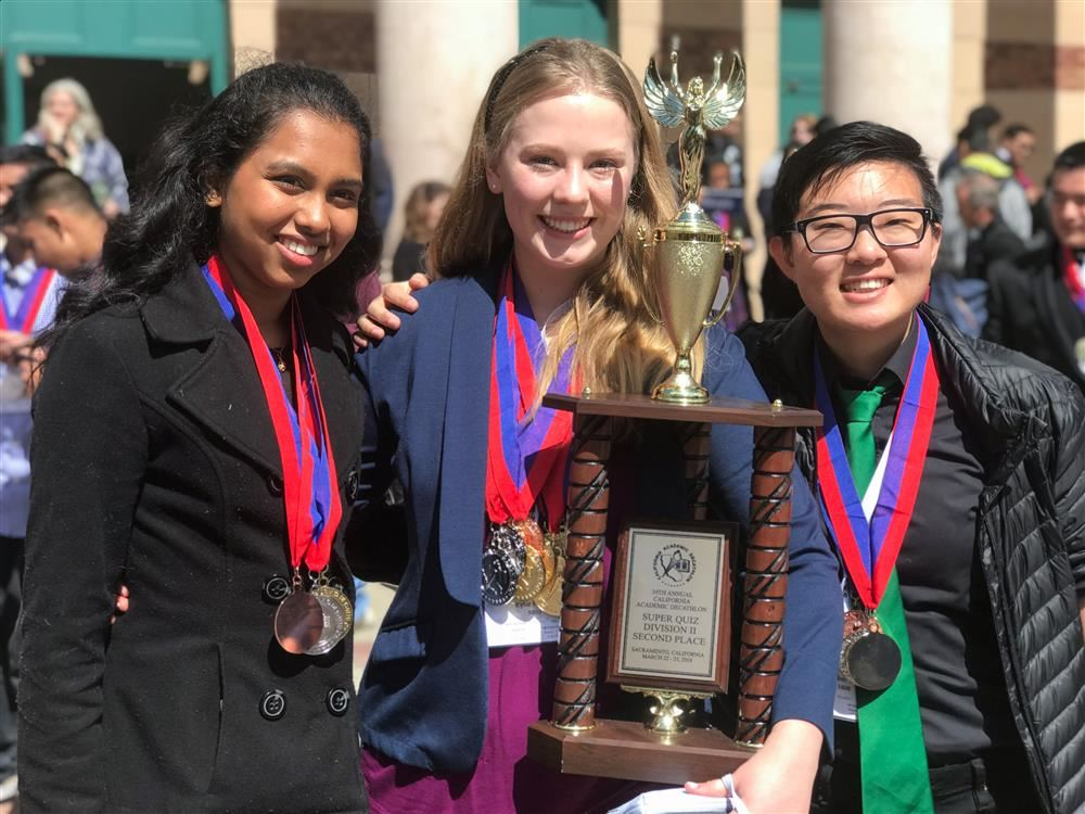 Casa Academic Decathlon students with trophy