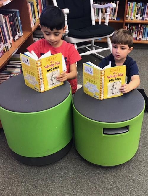 Two boys reading together