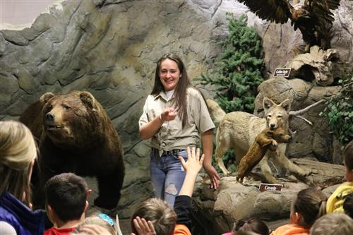 Student giving a tour at wild life museum